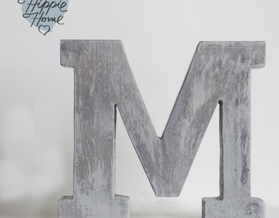 M gris